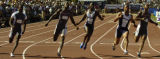 (Sacramento, Calif. on SUNDAY, July 11,2004) -- Maurice Greene, second from right, edges out...