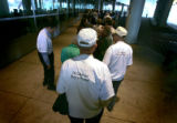 Deane Munger (cq, center), 74, of Fort Collins stands in a long line with other members of...