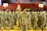 Members of Lightning Troop, 3rd Armored Cavalry Regiment, gather in formation in the gym at...