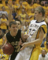 Pagosa Springs guard Paul Przybylski, left, looks to pass the ball being defended by Roaring Forks...