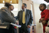 The Rev. Gil Caldwell,(cq) (center)  a noted Denver activist, shakes hands with Ashley Combs (cq)...
