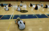 Women ages 50 to 75 years old playing in the Colorado Women's 3-A-Side basketball league stretch...