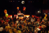 Over 500 parents along with their children dance to disco at the Boulder Theater in Boulder, Colo,...