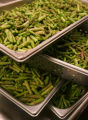 Pans of asparagus will be added to the cavatappi pasta for a lunch banquet at the new Hyatt on...
