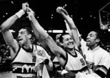 Alex English, left, Mike Evans and Fat Lever celebrate after the Denver Nuggets clinched the...