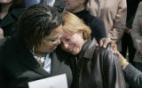 Tamika Payne (cq), left, comforts Terri Schreiber (cq), right, after Schreiber spoke in support of...
