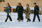 Principal Jana Frieler, (l) (cq reporter) lead a group of police, public information officer...