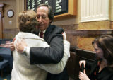 Steve Farber (cq) is hugged by State Rep Nancy Todd (D- HD 41) after Farber and the American...