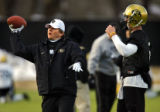 New University of Colorado football coach Dan Hawkins (left) gives Patrick Devenny (#5, QB) a few...