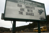 One side of a Conifer High School message board expresses sentiments for members of the Graves...