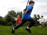 Boulder, Colo., photo taken July 26, 2004-Ty McMillen (center),9, of Boulder, Colo., runs from...