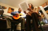Samuel Hernandez, cq, 47, left and his wife Rosalia Hernandez, cq, 42, sing a church song in...