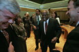 US Supreme Court Justice Clarence Thomas jokes with a room filled with Denver officials. In...
