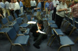 (DENVER, Colo., photo taken July 26, 2004) Josh Wolf, of Denver, remains reading on the floor...