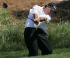 GAJB101 - Golfer Phil Mickelson hits from the tee on the fifth hole during a pro-am round before...