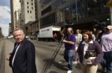 Dave Minshall (cq), a spokesperson for RTD, leads a line of media across Stout Street before a...