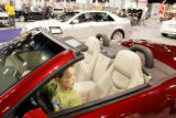 Alejandro Manzano, 6, Greeley, sits in the driver's seat of a Cadillac Edlorado convertable at...