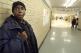 After a journey of three bus rides, Terrell Mitchell (cq) stands in the hallway of John F. Kennedy...