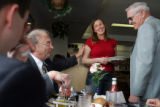Walnut Cafe server Jessica Stuart, cq, center, chats with Colorado State Senators Jim Isgar, left,...