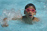 (DENVER, Colo., July 12, 2004) Marco Herrera, 9, is learning to swim  at the Colorado Academy, an...
