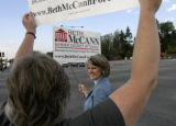 (DENVER, Colo., July 12, 2004) Jenny Anderson installs a sign in the front yard of Mrs. Dorothy...
