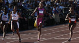 (SATURDAY, July 10, 2004 in SACRAMENTO) Marion Jones, center, crosses the finish line in 11.14...