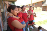 [(Denver, colo., Shot on: 7/12/04)] Sisters (from left) Marie Sandoval, 21, (holds her Nephew...