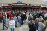 JPM206  People stand outside of Cox Arena, the site of a first round games in the NCAA basketball...