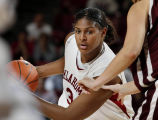 University of Oklahoma (OU)'s Courtney Paris dribbles toward the basket as the Sooner women's...