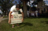 (DENVER, Colo., July 12, 2004) Jenny Anderson installs a lawn sign as Rosemary Marshall talks with...