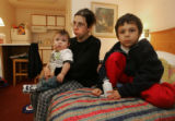 Joelene Mix (cq) sits in a hotel room in Glendale with her two sons, Carlos Mondragon, 7 and Joe...