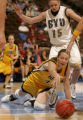 Iowa's Megan Skouby, bottom, scrambles for the basketball with BYU's Jennie Keele, top, guarding...