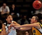 BYU's Ambrosia Anderson, left, passes the ball being defended by Iowa's Wendy Ausdemore, right, in...