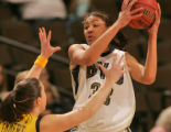 Iowa's Abby Emmert, left, guards  BYU's Ambrosia Anderson, rigth, in the first half of play in the...