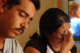 (DENVER, Colo., July 12, 2004) (Lt. to Rt.) Federico Salazar, 29, and wife Fabiola Romero, 30,...