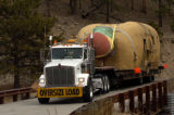 Sema Construction employee Terry Renzelman drives the semi-trailer across the last bridge in...