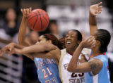 Florida State's Alicia Gladden, middle, is tangled up by  Louisiana Tech defenders Shan Moore,...