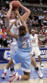 Florida State's Nikki Anthony, top, grabs a rebound being defended by Louisiana Tech's Shan Moore,...