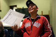 Javier Rodriguez (cq) of Denver laughs at his response to an English exercise question during a...