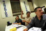 Fernando Rodriguez (cq) raises his hand to ask a question during a recent English as a Second...
