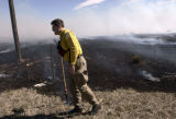 Eric Phillips of Boulder Rule Fire Fighters helps contain a wild fire that threatened residents...