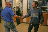 Alton Howard (cq), 49, left, a 14 year employee of RTD shakes Rich Hladyszewski,44, rigth, a six...