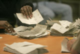 Ballots are counted in IBEW Hall located at 5660 Logan St., Sunday evening April 2, 2006. A RTD...