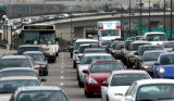 A RTD bus makes it's way through heavy traffic eastbound Park Avenue West in to Denver Monday Apr....