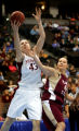 Stanford's Kristen Newlin (#43) lays up a shot over Florida State's Nikki Anthony (#44) during the...
