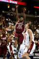 Florida State's Shante Williams (#22) throws up a shot over Stanford's Brooke Smith (#30) during...