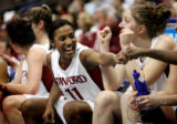 Stanford's Candice Wiggins (#11) celebrates on the bench at the end of the game with teammates...