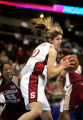 Stanford's Brooke Smith (#30) hauls in a rebound in front of Florida State's Alicia Gladden (#23)...