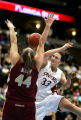 Stanford's Jillian Harmon (#33) has her shot blocked by Florida State's Nikki Anthony (#44) during...