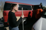 Susie Stanzel, (cq) from Kansas who is blind, waits for her turn to get on a van that will take a...